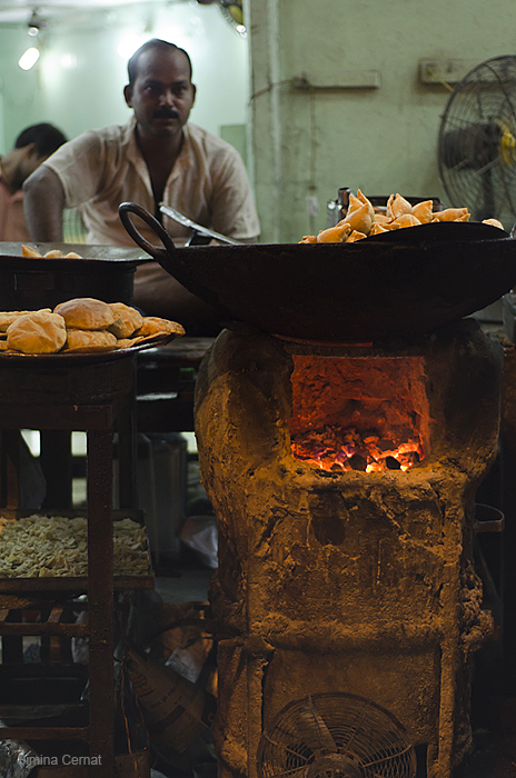 Man cooking in India
