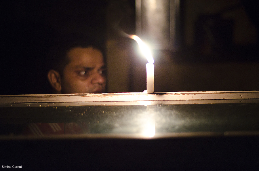 Man waiting for electricity in Varanasi India