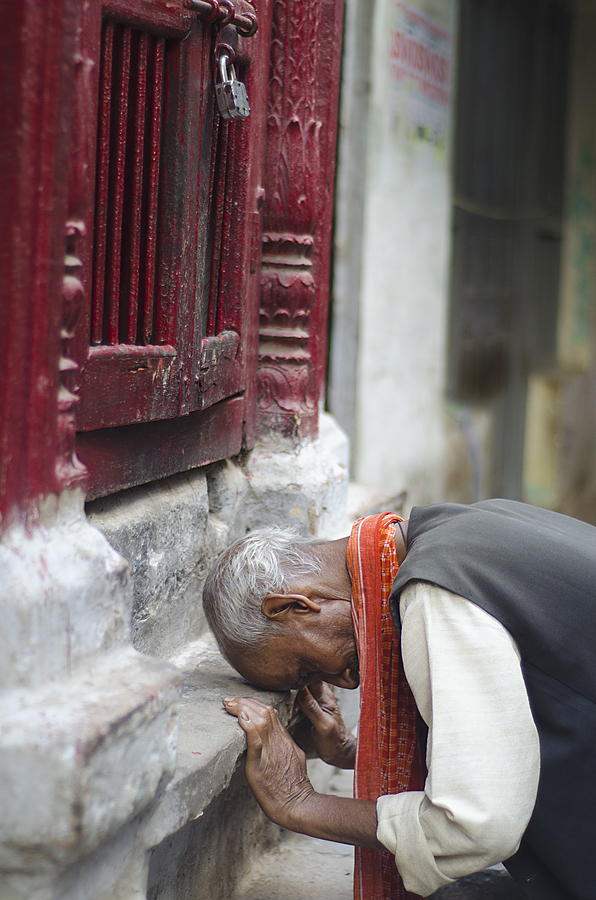 Old man praying in Varanasi India