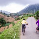 Children cycling in Dieng Plateau, Central Jawa, Indonesia